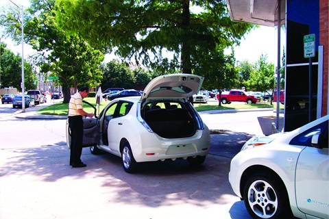 Oklahoma City's new Nissan LEAF vehicles were delivered on Aug. 16. Bill Hager, fleet services administrator, is shown checking them for specification compliance.